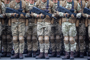 Soldiers with automatic rifles in the ranks. Armament