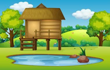 Hut in pond nature scene