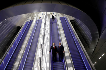 Israeli PM Netanyahu stands next to Israel's Transportation and Intelligence Minister Katz as they visit the new high-speed train between Jerusalem and Tel Aviv, at Yitzhak Navon Railway Station in Jerusalem
