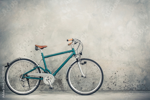 Retro bike with aged leather postman's bag and old sneakers front