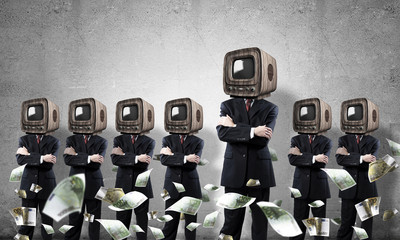 Businessmen with old TV instead of head.