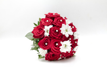 Wedding bouquet made of red roses and pearls isolated on a white background