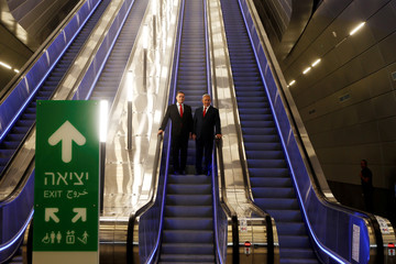 Israeli Prime Minister Benjamin Netanyahu stands next to Israel's Transportation and Intelligence Minister Yisrael Katz as they visit the new high-speed train between Jerusalem and Tel Aviv, at Yitzhak Navon Railway Station in Jerusalem
