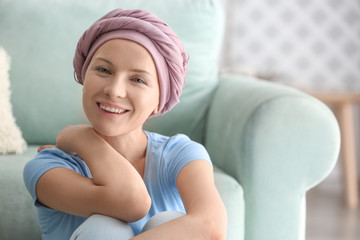 Happy woman after chemotherapy at home