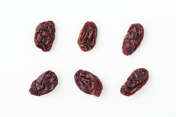 Raisins isolated on white, top view