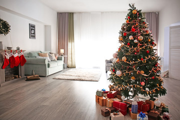 Beautiful decorated Christmas tree in cozy living room