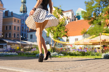 Woman with beautiful legs wearing skirt and heels Wall mural