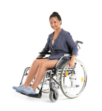 Asian woman in wheelchair on white background