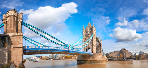 Wall Mural - Tower Bridge in London, England, on a bright sunny day under gorgeous sky with clouds