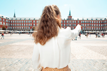 tourist woman at Plaza Mayor pointing at something