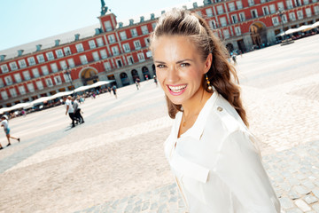 happy stylish tourist woman at Plaza Mayor in Madrid, Spain