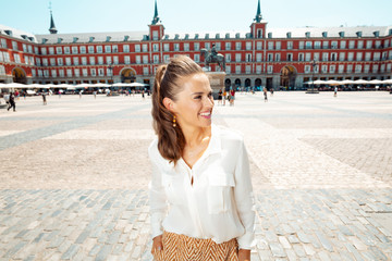 woman at Plaza Mayor in Madrid, Spain exploring attractions