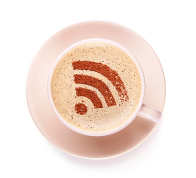 Cup of coffee with WiFi sign on the foam. Free access point to the Internet WiFi