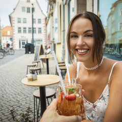 young brunette woman having ice tea