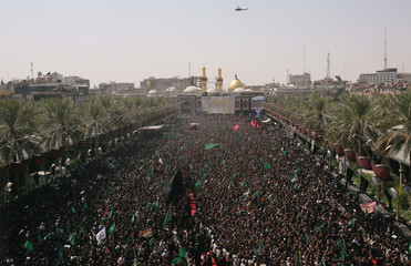 Iraqi Shi'ite pilgrims run between the Imam Hussein and Imam Abbas shrines as part of a ritual of the Ashura ceremony in Karbala