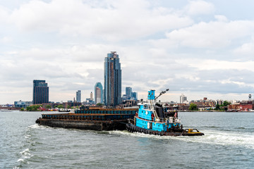 Tugboat pushing barge in New York City