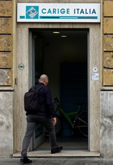 A man enters a Carige bank in Rome