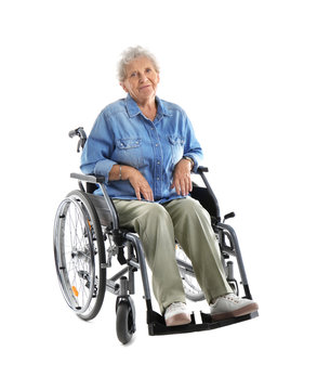 Senior woman in wheelchair on white background