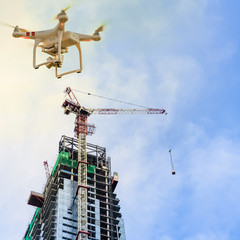 Drone over construction site of modern office and residential building in Singapore. Concept of video surveillance or industrial safety inspection