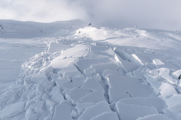 Snow avalanche in winter mountains. Danger extreme concept