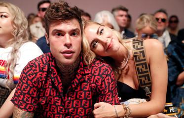 Italian fashion blogger Chiara Ferragni and her husband Italian rapper Fedez pose before Fendi's show during Milan Fashion Week