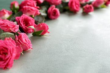 Beautiful flowers on grey background