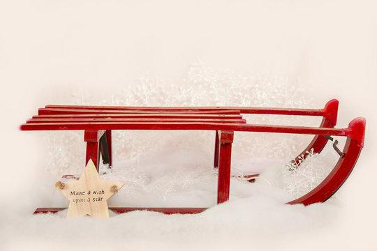 Seasonal, Christmas red sledge with 'Make a wish upon a star' sign