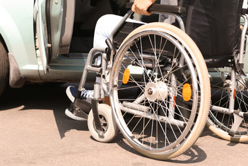 Handicapped woman getting into her car