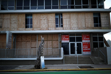 A closed business shop is seen at a touristic area of Condado, a year after Hurricane Maria devastated Puerto Rico, in San Juan