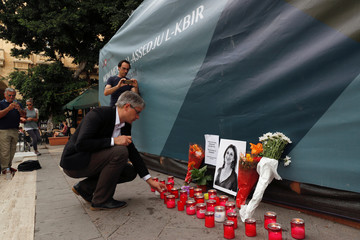 Member of European Parliament Sven Giegold, part of the delegation from the Rule of Law Monitoring Group of the European Parliament, places a candle for assassinated anti-corruption journalist Daphne Caruana Galizia