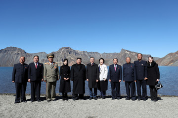 South Korean President Moon Jae-in, first lady Kim Jung-sook, North Korean leader Kim Jong Un and his wife Ri Sol Ju pose for photographs with North Korean aides beside the Heaven Lake of Mt. Paektu