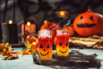Creative glasses with jelly dessert prepared for Halloween party on table Fototapete