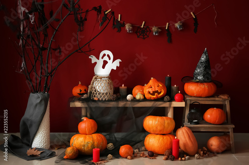 Creative decorations for Halloween party near color wall