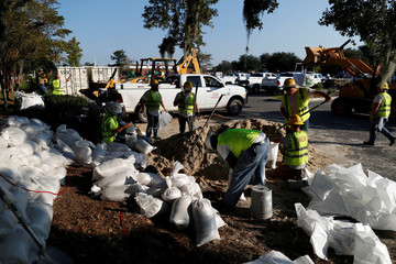 Workers place sand bags in anticipation of flood waters in the aftermath of Hurricane Florence now downgraded to a tropical depression in Conway