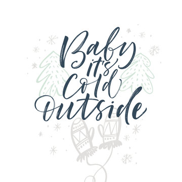 Baby it's cold outside card. Hand drawn vector modern calligraphy. Ink illustration. Happy holidays poster.