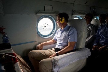 Britain's Foreign Secretary Jeremy Hunt looks from the helicopter window as he travels to Maungdaw in Rakhine state