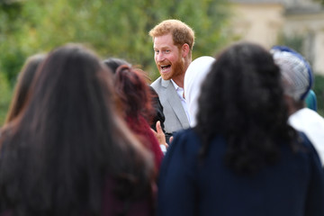 Britain's Prince Harry, departs after attending the launch of a cookbook with recipes from a group of women affected by the Grenfell Tower fire at Kensington Palace in London