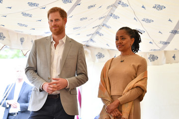 Britain's Prince Harry, and Doria Ragland listen to Meghan, Duchess of Sussex speaking at the launch of a cookbook with recipes from a group of women affected by the Grenfell Tower fire at Kensington Palace in London