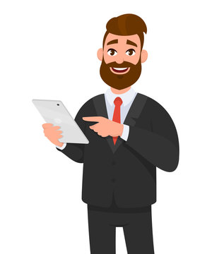 Happy confident business man holding or using a tablet computer. Business man standing isolated in white background gesturing hand using tablet PC.
