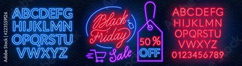 Fototapete Black Friday neon lettering on brick wall background with the alphabet