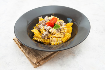 Radiatori pasta in a creamy tomato parmesan cheese sauce