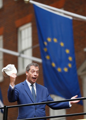 Nigel Farage passes a European Union flag as he rides a bus while campaigning against Britain's Prime Minister Theresa May's Chequers Brexit plan, in central London