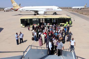 Passengers board a flight at Misrata airport in Misrata