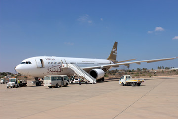 A Libyan Airways aircraft stands on the runway at Misrata airport in Misrata