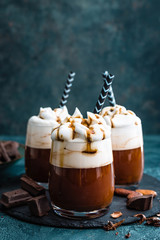 Hot chocolate with whipped cream. Chocolate dessert drink in glass