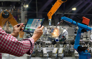 Engineer touch screen control robot the production of factory parts engine manufacturing industry...