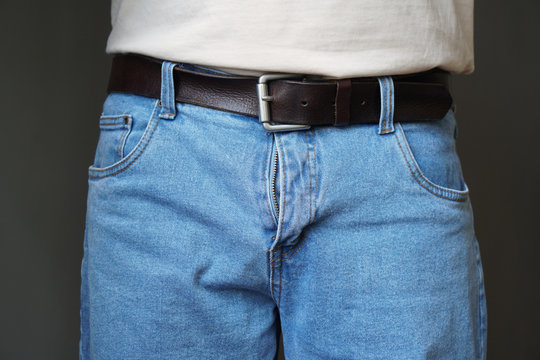 midsection of unrecognizable man dressed in jeans with open fly or flies or zipper