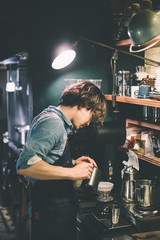 Barista brewing coffee