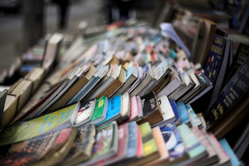 Second-hand books are for sale on a street in Tegucigalpa