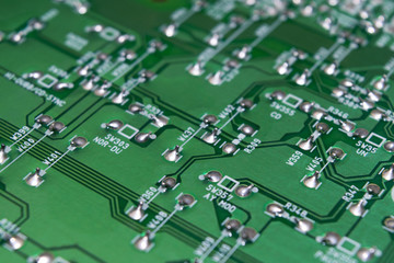 part of an electronic circuit board with a microcircuit and electronic components.
